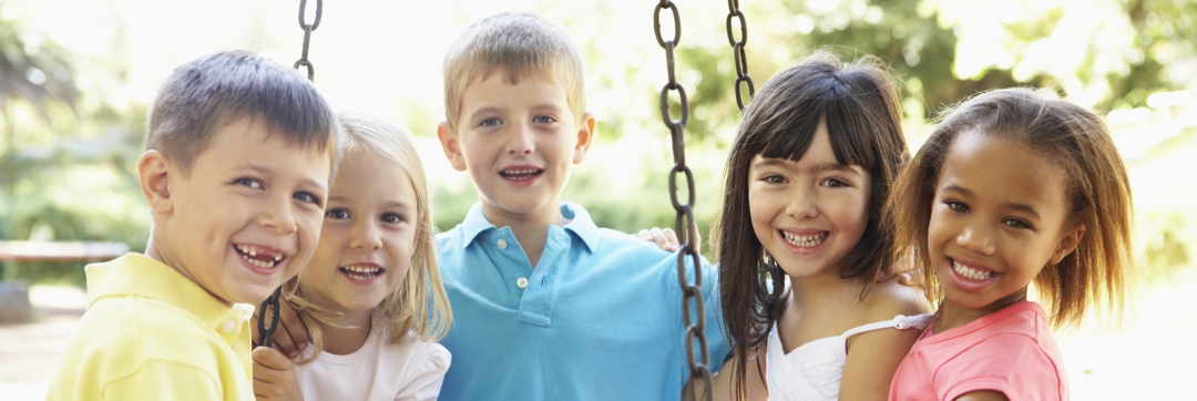 healthy children playing on swing