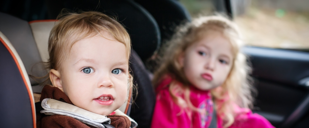two children in car seats