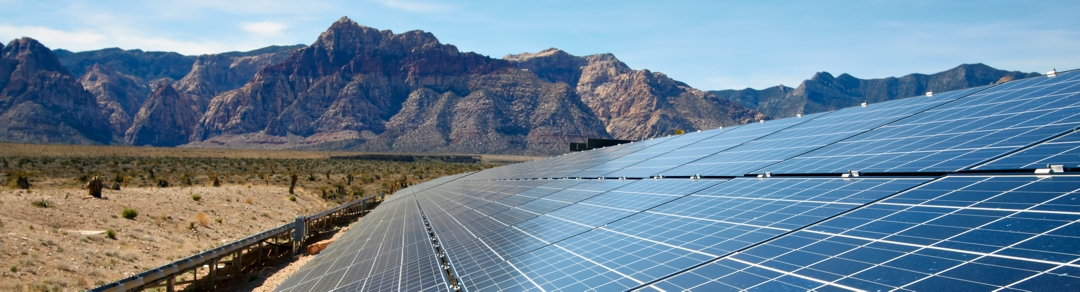 solar panels against a desert mountain background