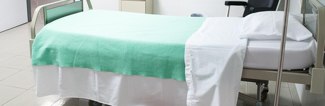 freshly made hospital bed