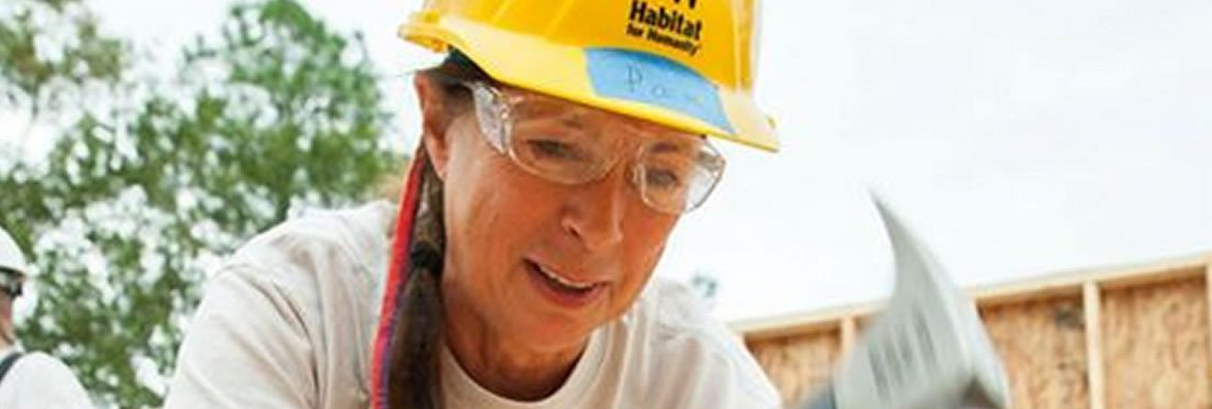 woman with hammer - photo from Habitat for Humanity Tucson