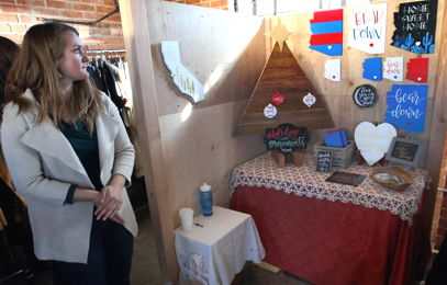 Local First - Modern Aquarian owner Ashley White with her booth
