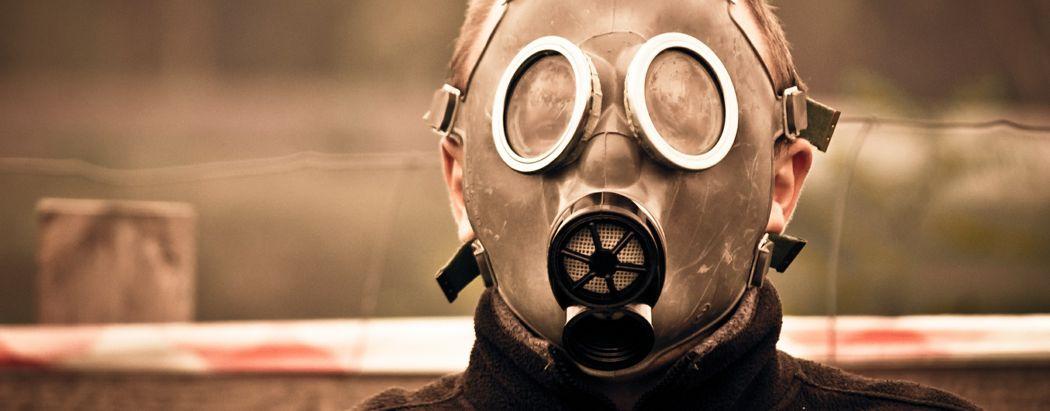 Chlorpyrifos, man wearing gas mask