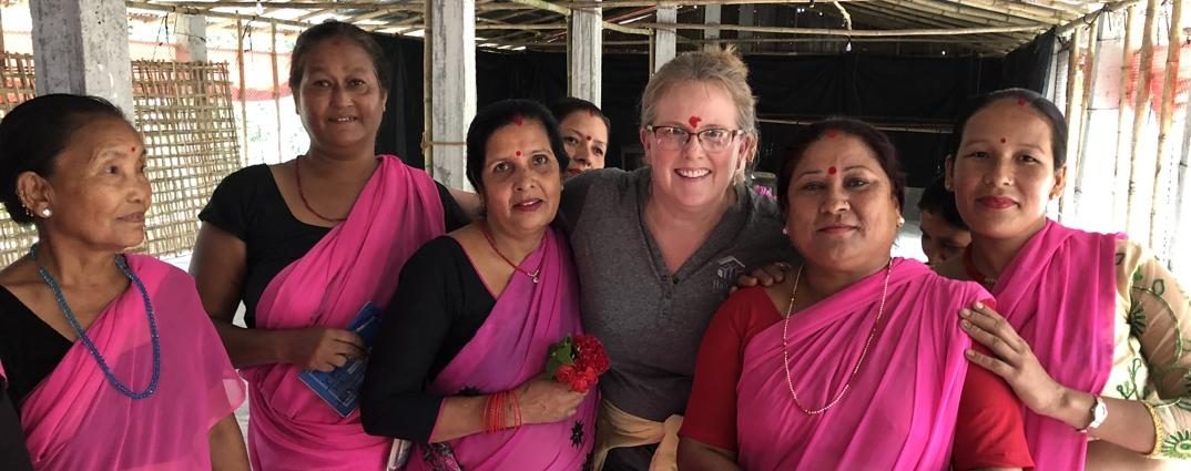 group of women in Nepal wearing pink saris
