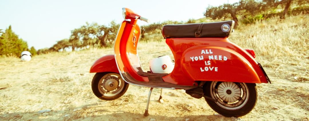 "Motor scooter with words ""all you need is love"" written on the side"