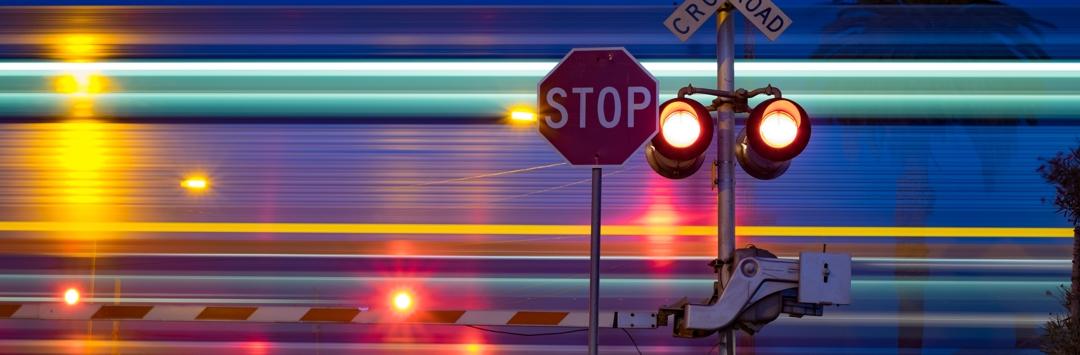 flashing light at night at railroad track