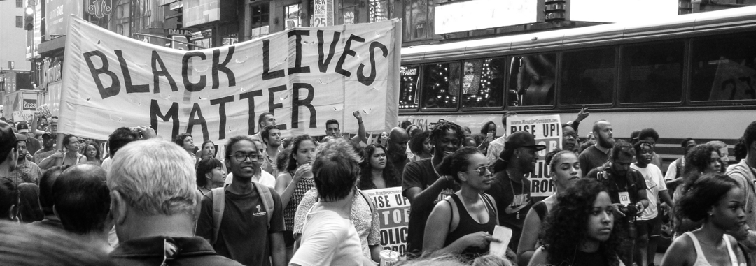 Black lives matter rally carrying signs and marching