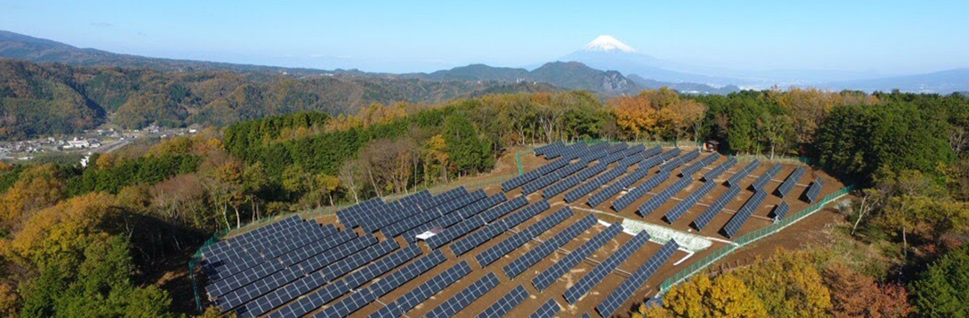 vast number of solar panels with mountains in background