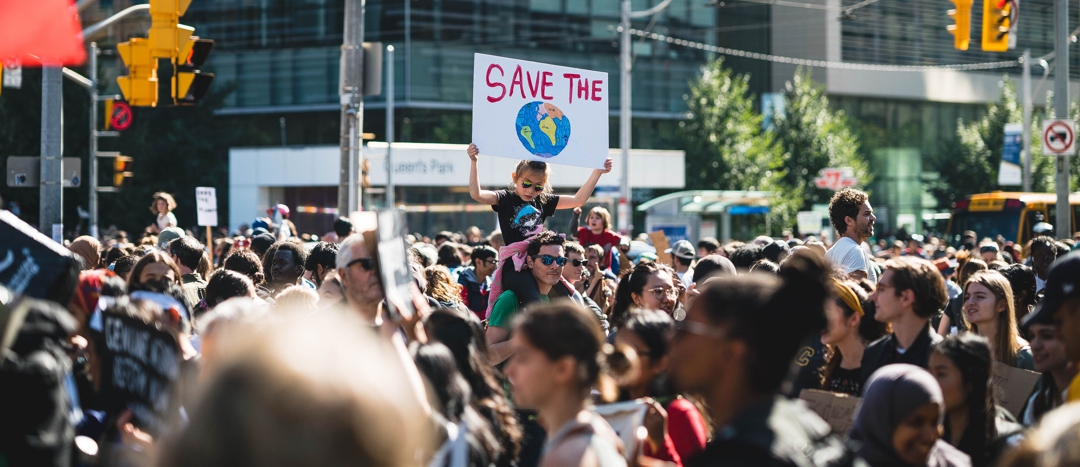 city street scene: group of youth rallying for climate change