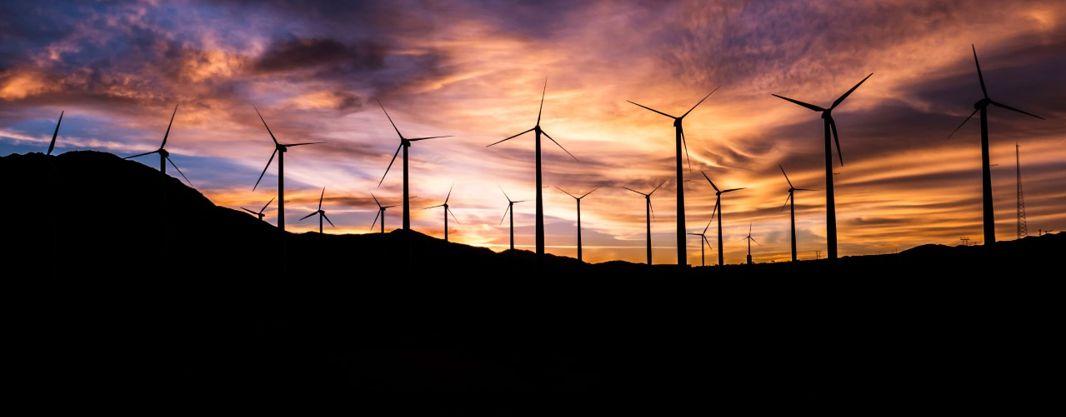 wind turbines against the sunset