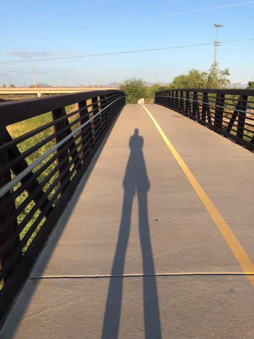 author taking photo of her shadow on bridge