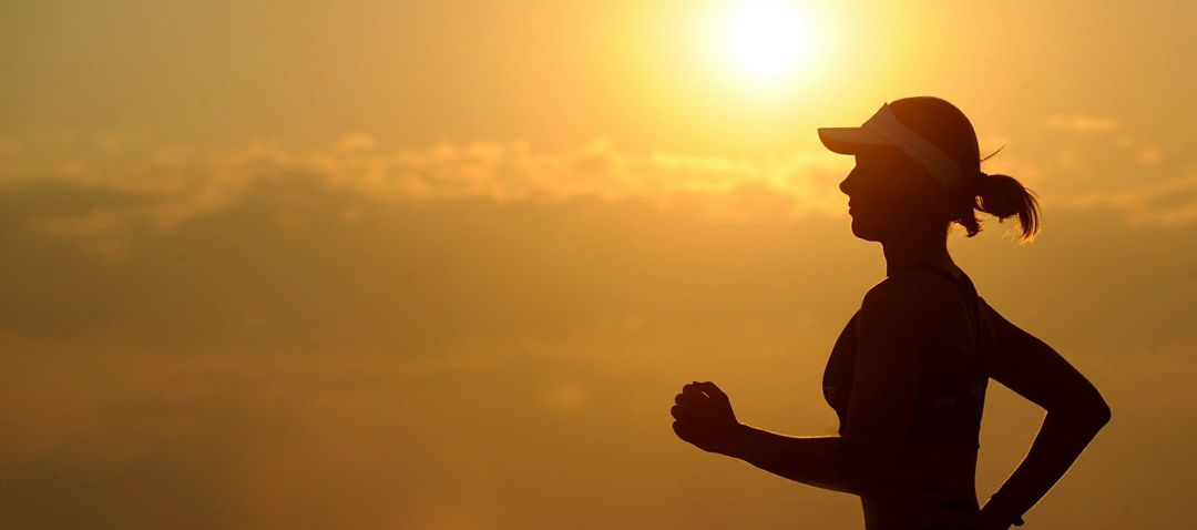 woman jogging in early morning light