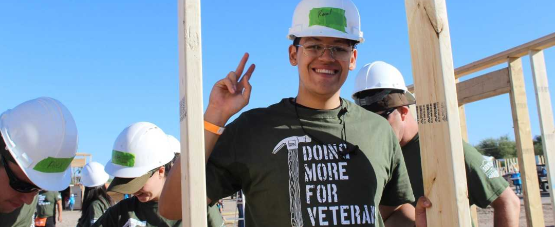 "Young man wearing t-shirt that says ""doing more for veterans""."