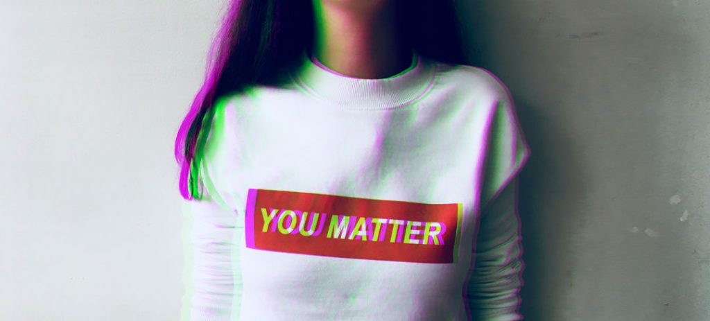 "young woman wearing T-shirt that says ""you matter"""