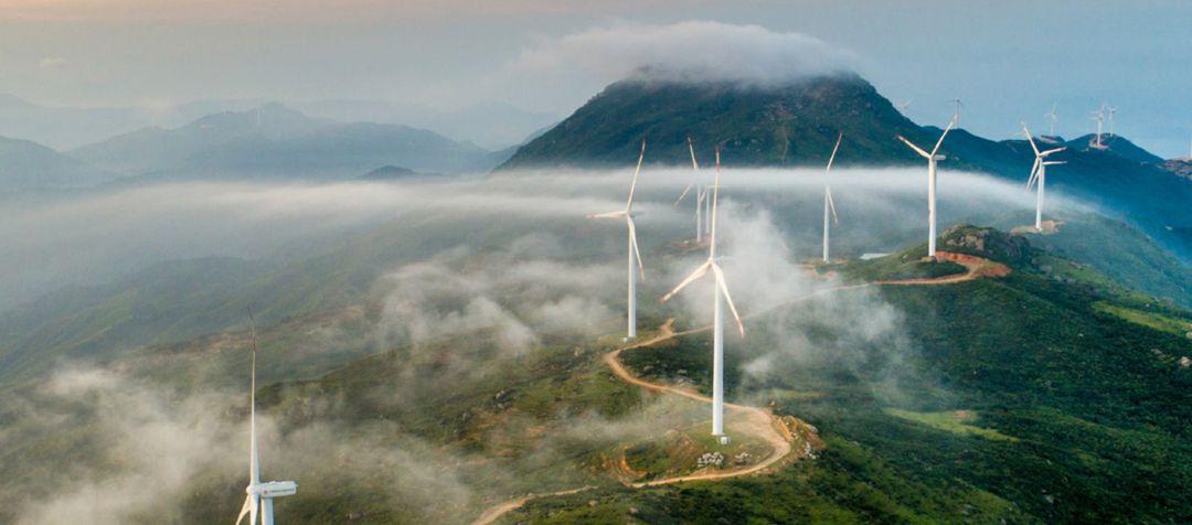 Wind turbines dotting the top of a mountain ridge