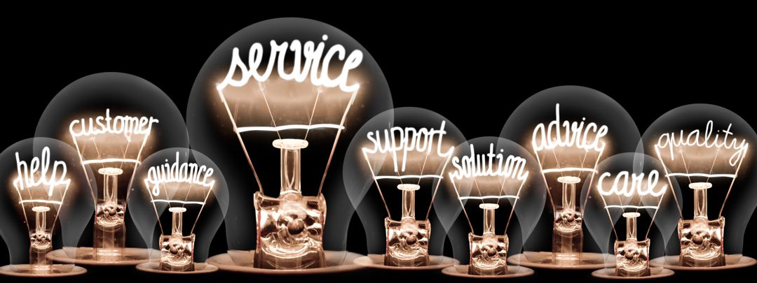 light bulbs glowing with community support messages inside each bulb