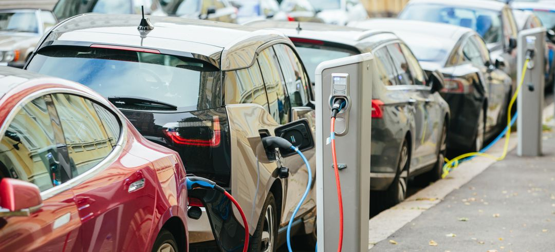 Electic vehicles plugged into public charging stations