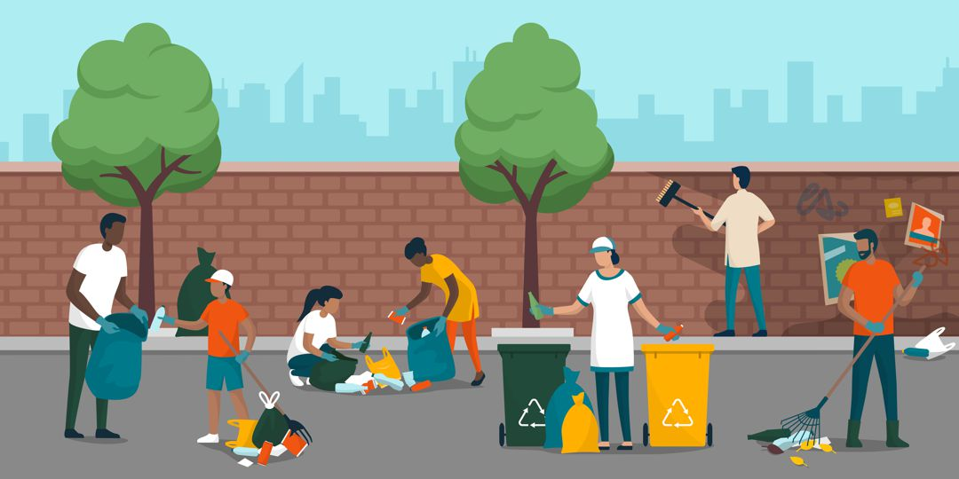 Young people volunteering and cleaning up the city street, they are collecting waste, removing dirt from a wall and separating garbage into different trash bins, environmental care concept